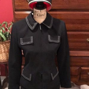 Two piece ladies black suit with white piping.